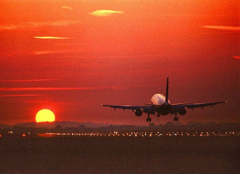 Plane.taking.off.with.orange.sunset.jpg