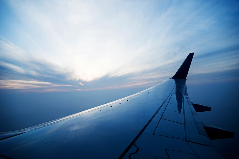 plane-wing-blue-sky
